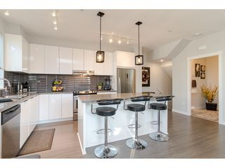 """Photo 13: 130 8138 204 Street in Langley: Willoughby Heights Townhouse for sale in """"Ashbury and Oak"""" : MLS®# R2510885"""