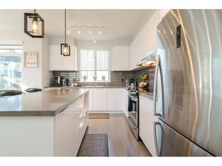 """Photo 14: 130 8138 204 Street in Langley: Willoughby Heights Townhouse for sale in """"Ashbury and Oak"""" : MLS®# R2510885"""