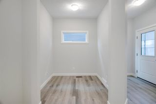 Photo 4: 201 RAVENSTERN Crescent SE: Airdrie Detached for sale : MLS®# A1019467