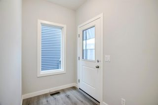 Photo 3: 201 RAVENSTERN Crescent SE: Airdrie Detached for sale : MLS®# A1019467