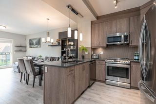 Photo 4: 108 3525 CHANDLER ST in COQUITLAM: Burke Mountain Townhouse for sale (Coquitlam)  : MLS®# R2409580