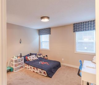 Photo 35: 311 Kinniburgh Road: Chestermere Detached for sale : MLS®# A1059533