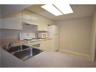 "Photo 3: 805 1196 PIPELINE Road in Coquitlam: North Coquitlam Condo for sale in ""THE HUDSON"" : MLS®# V990430"