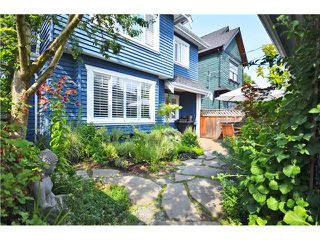 Photo 1: 1730 E 7TH Avenue in Vancouver: Grandview VE House 1/2 Duplex for sale (Vancouver East)  : MLS®# V1026490