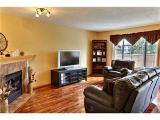 Photo 2: 201 TUSCANY RAVINE TC NW in CALGARY: Tuscany House for sale (Calgary)  : MLS®# C3565814
