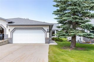 Main Photo: 60 ARBOUR CLIFF Court NW in Calgary: Arbour Lake Semi Detached for sale : MLS®# C4306410
