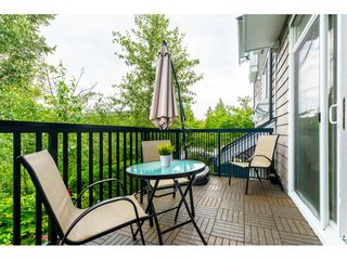 """Photo 14: 102 14833 61 Avenue in Surrey: Sullivan Station Townhouse for sale in """"Ashbury Hill"""" : MLS®# R2478768"""