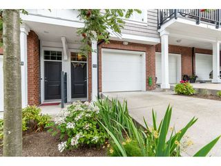 """Photo 2: 102 14833 61 Avenue in Surrey: Sullivan Station Townhouse for sale in """"Ashbury Hill"""" : MLS®# R2478768"""