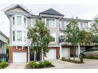 """Photo 1: 102 14833 61 Avenue in Surrey: Sullivan Station Townhouse for sale in """"Ashbury Hill"""" : MLS®# R2478768"""