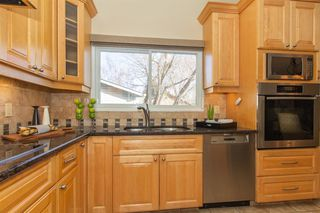 Photo 5: 9808 ALCOTT Road SE in Calgary: Acadia Detached for sale : MLS®# A1032745