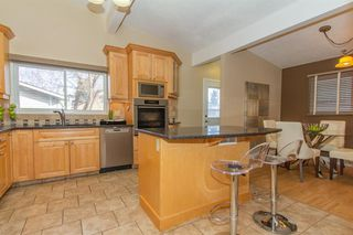 Photo 3: 9808 ALCOTT Road SE in Calgary: Acadia Detached for sale : MLS®# A1032745