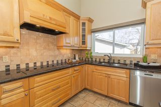 Photo 4: 9808 ALCOTT Road SE in Calgary: Acadia Detached for sale : MLS®# A1032745