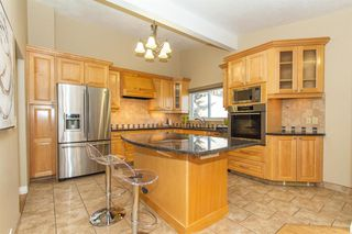 Photo 2: 9808 ALCOTT Road SE in Calgary: Acadia Detached for sale : MLS®# A1032745