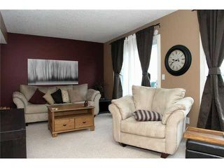 Photo 5: 336 BRIDLEWOOD Lane SW in CALGARY: Bridlewood Townhouse for sale (Calgary)  : MLS®# C3537460