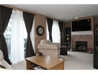 Photo 6: 336 BRIDLEWOOD Lane SW in CALGARY: Bridlewood Townhouse for sale (Calgary)  : MLS®# C3537460
