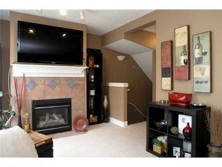 Photo 4: 336 BRIDLEWOOD Lane SW in CALGARY: Bridlewood Townhouse for sale (Calgary)  : MLS®# C3537460