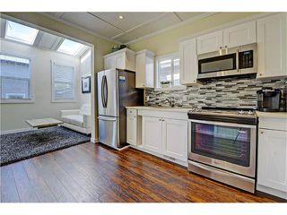Photo 5: 309 28 AV NE in Calgary: Tuxedo Park House for sale : MLS®# C4066138