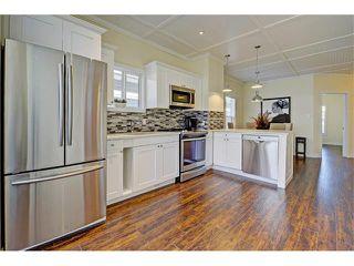 Photo 7: 309 28 AV NE in Calgary: Tuxedo Park House for sale : MLS®# C4066138