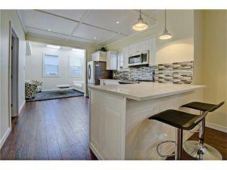 Photo 1: 309 28 AV NE in Calgary: Tuxedo Park House for sale : MLS®# C4066138