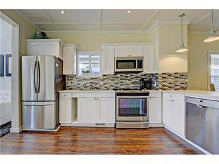 Photo 6: 309 28 AV NE in Calgary: Tuxedo Park House for sale : MLS®# C4066138