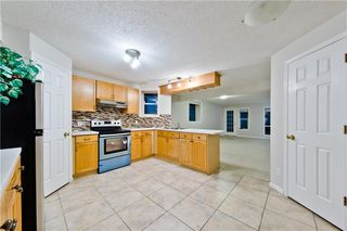 Photo 12: BRIDLEWOOD PL SW in Calgary: Bridlewood House for sale