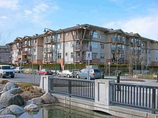 "Main Photo: 308 500 KLAHANIE Drive in Port Moody: Port Moody Centre Condo for sale in ""TIDES"" : MLS®# R2403945"