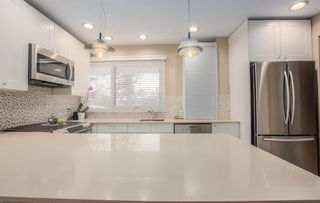 Photo 14: 8232 10 Street SW in Calgary: Chinook Park Detached for sale : MLS®# A1055347