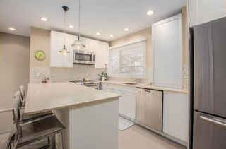 Photo 11: 8232 10 Street SW in Calgary: Chinook Park Detached for sale : MLS®# A1055347