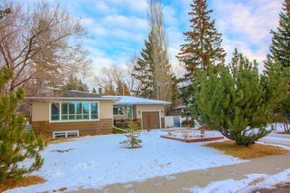 Photo 3: 8232 10 Street SW in Calgary: Chinook Park Detached for sale : MLS®# A1055347
