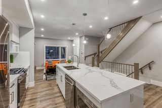 Photo 11: 1191 42 Street in Calgary: Montgomery Row/Townhouse for sale : MLS®# A1054999