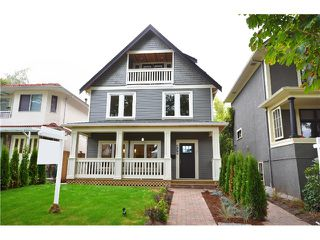 Photo 1: 528 E 10TH AV in Vancouver: Mount Pleasant VE House 1/2 Duplex for sale (Vancouver East)  : MLS®# V1024473