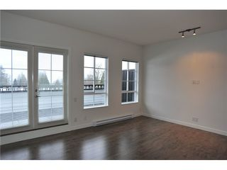 Photo 2: # 415 553 FOSTER AV in Coquitlam: Coquitlam West Condo for sale : MLS®# V1091616