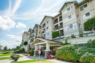 "Main Photo: 402 19673 MEADOW GARDENS Way in Pitt Meadows: North Meadows PI Condo for sale in ""The Fairways"" : MLS®# R2405625"