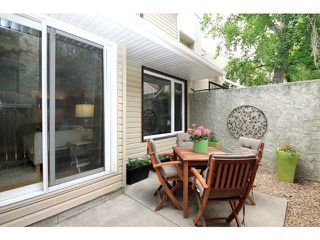 Photo 1: 161 76 GLAMIS Green SW in CALGARY: Glamorgan Stacked Townhouse for sale (Calgary)  : MLS®# C3572473