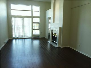 Photo 1: # 411 301 MAUDE RD in Port Moody: North Shore Pt Moody Condo for sale : MLS®# V1052665