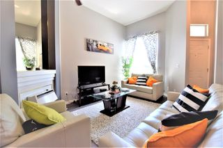 Photo 1: 205 13900 HYLAND Road in Surrey: East Newton Townhouse for sale : MLS®# R2391258