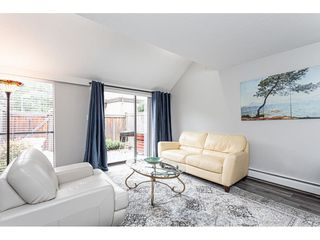 """Photo 2: 106 17720 60 Avenue in Surrey: Cloverdale BC Townhouse for sale in """"CLOVER PARK GARDENS"""" (Cloverdale)  : MLS®# R2503814"""