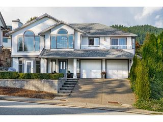 Photo 1: 2893 DELAHAYE Drive in Coquitlam: Scott Creek House for sale : MLS®# R2509478