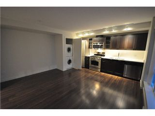 "Photo 1: 201 4888 NANAIMO Street in Vancouver: Victoria VE Condo for sale in ""2300 Kingsway"" (Vancouver East)  : MLS®# V983782"