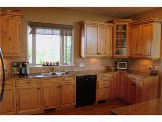 Photo 6: 88 RAVENCREST Drive in ALDERSYDE: Rural Foothills M.D. Residential Detached Single Family for sale : MLS®# C3582475