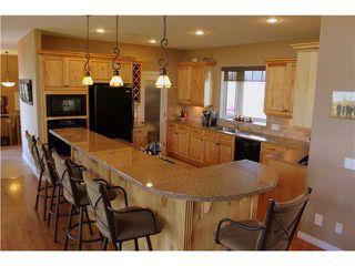 Photo 5: 88 RAVENCREST Drive in ALDERSYDE: Rural Foothills M.D. Residential Detached Single Family for sale : MLS®# C3582475