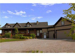 Photo 1: 88 RAVENCREST Drive in ALDERSYDE: Rural Foothills M.D. Residential Detached Single Family for sale : MLS®# C3582475