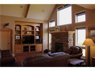 Photo 4: 88 RAVENCREST Drive in ALDERSYDE: Rural Foothills M.D. Residential Detached Single Family for sale : MLS®# C3582475