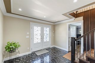 Photo 2: 7409 124 Street in Surrey: West Newton House for sale : MLS®# R2396946