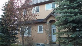 Main Photo: 147 23 Avenue NW in Calgary: Tuxedo Park Row/Townhouse for sale : MLS®# A1047875