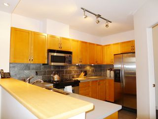 Photo 3: 309 2263 REDBUD Lane in TROPEZ: Home for sale : MLS®# V1025643