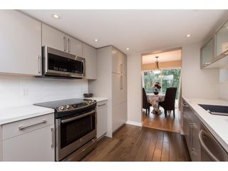 """Photo 2: 15967 ALDER Place in Surrey: King George Corridor Townhouse for sale in """"ALDERWOOD"""" (South Surrey White Rock)  : MLS®# R2478330"""