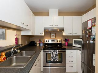 "Photo 10: 202 2355 W BROADWAY in Vancouver: Kitsilano Condo for sale in ""CONNAUGHT PARK PLACE"" (Vancouver West)  : MLS®# R2464829"