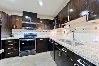 Photo 7: 77 SPRUCE PL SW in Calgary: Spruce Cliff Condo for sale