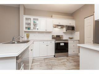 "Photo 7: #402 13860 70 Avenue in Surrey: East Newton Condo for sale in ""Chelsea Gardens"" : MLS®# R2435738"